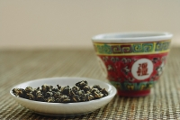 Plate of Tea leaves with Chinese teacup - Asia Images Group
