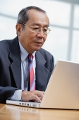 Businessman with laptop - Asia Images Group