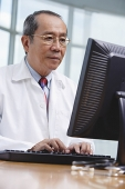 Doctor using desktop computer - Asia Images Group