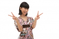 Young woman making peace sign with fingers - Asia Images Group