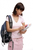 Young woman with backpack and books - Asia Images Group