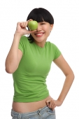 Young woman in green T-shirt with green apple - Asia Images Group