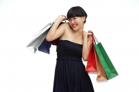 Young woman in black dress with shopping bags - Asia Images Group