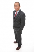 Businessman standing with hands in pocket - Asia Images Group