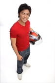 Young man with motorcycle helmet, smiling at camera - Asia Images Group