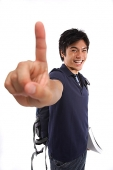 Young man making hand sign - Asia Images Group