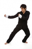 Young man practicing Kong fu - Asia Images Group