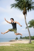Man jumping in air - Asia Images Group