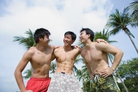 Three men with arms around each other - Asia Images Group