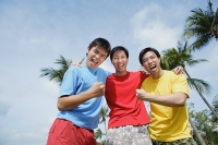 Three men with arms around each other, looking at camera - Asia Images Group