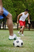 Two men playing soccer - Asia Images Group