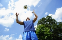 Man catching soccer ball - Asia Images Group