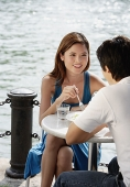 Couple sitting at outdoor cafe - Asia Images Group