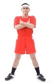 Man in soccer uniform, arms crossed, smiling at camera - Asia Images Group