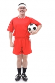 Man in soccer uniform holding soccer ball, portrait - Asia Images Group