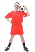 Man in soccer uniform holding soccer ball on shoulder - Asia Images Group
