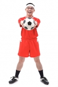 Man in soccer uniform holding soccer ball towards camera - Asia Images Group
