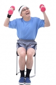 Man sitting on stool, lifting dumbbells - Asia Images Group