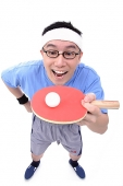 Man with ping pong racket, balancing ball - Asia Images Group
