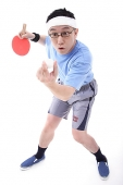 Man playing ping pong, preparing to serve - Asia Images Group