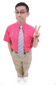 Man making peace sign, smiling at camera - Asia Images Group