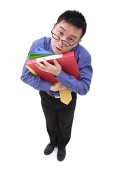 Tired Businessman carrying  multi coloured folders - Asia Images Group