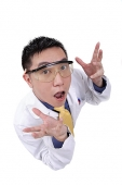 Doctor in lab coat, shocked expression, looking up at camera - Asia Images Group
