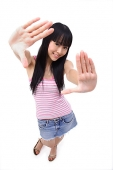 Young woman with hands outstretched, smiling at camera - Asia Images Group