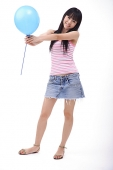 Young woman holding a blue balloon - Asia Images Group