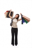 Woman carrying many shopping bags - Asia Images Group