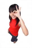 Young woman making Ok sign with fingers - Asia Images Group
