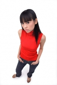 Young woman looking at camera, hands in pockets - Asia Images Group