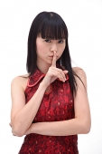 Young woman, finger on mouth - Asia Images Group