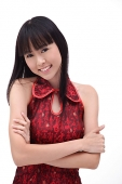 Young woman arms crossed, smiling - Asia Images Group