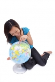 Woman pointing at globe - Asia Images Group