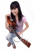 Young woman with guitar, portrait - Asia Images Group