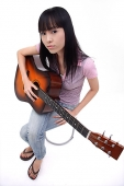 Young woman with guitar - Asia Images Group
