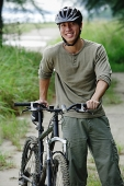 Man with bicycle, outdoors, portrait - Asia Images Group