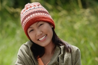 Woman with ski cap, wrapped in a blanket, portrait - Asia Images Group
