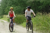 Couple cycling side by side - Asia Images Group