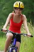 Woman cycling - Asia Images Group