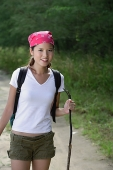 Female hiker smiling at camera, portrait - Asia Images Group