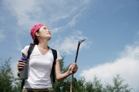 Female hiker looking up, low angle view - Asia Images Group