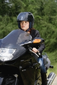Young woman riding motorbike - Asia Images Group