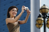Woman taking a picture - Asia Images Group