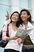 Two young women with map, looking up - Asia Images Group