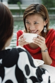 Two women having coffee - Asia Images Group