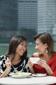 Two women having lunch - Asia Images Group