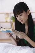 Young woman reading a book - Asia Images Group