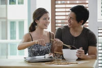 Couple in kitchen, making cookies - Asia Images Group